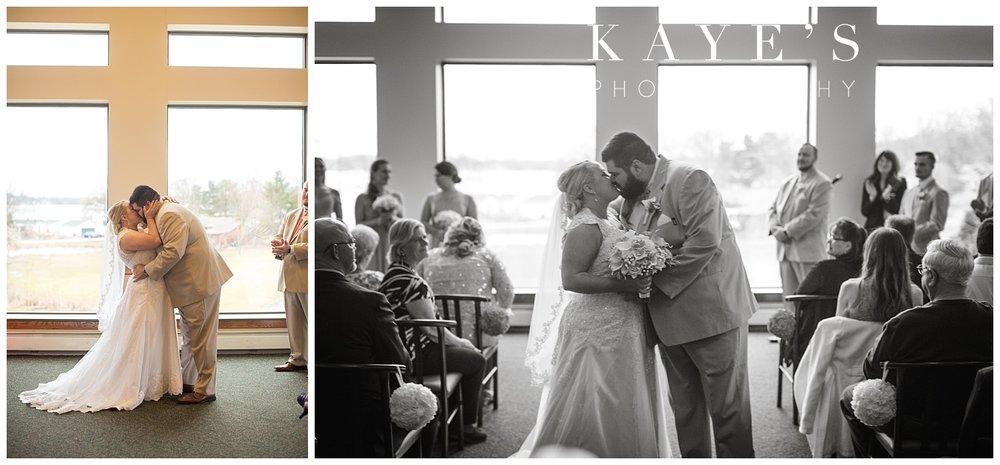 first kiss at indoor ceremony at lapeer country club by kayes photography