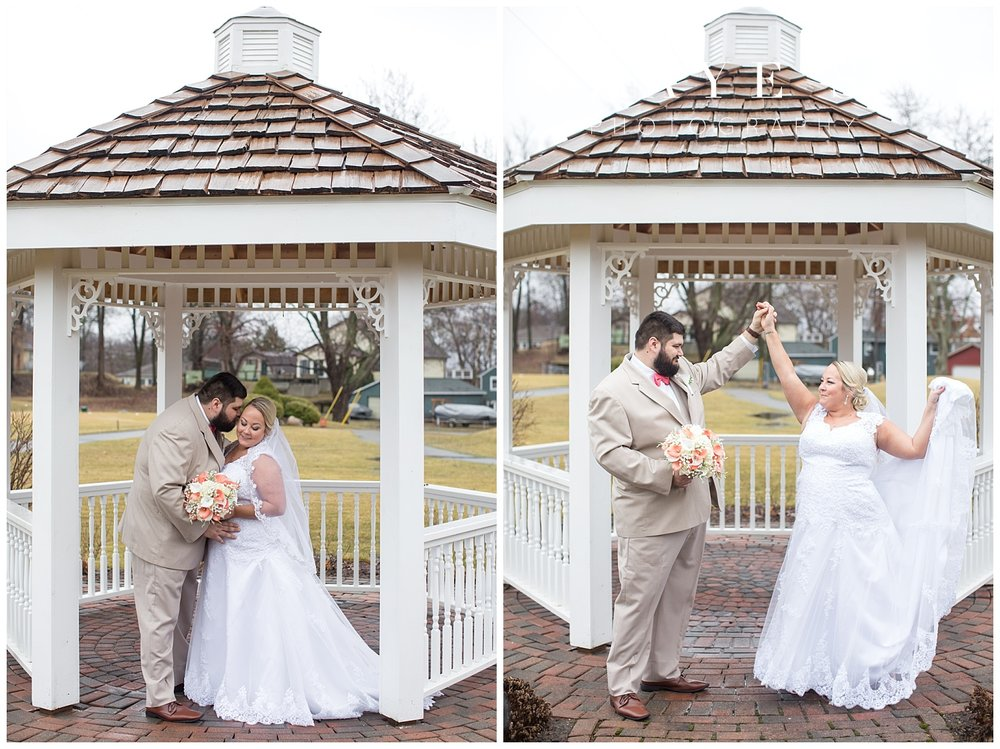 bride and groom outside in spring portraits during michigan wedding