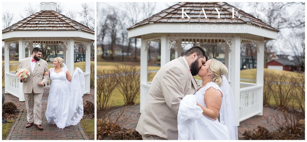 bride and groom photos in front of a gazebo at lapeer county club by kayes photography