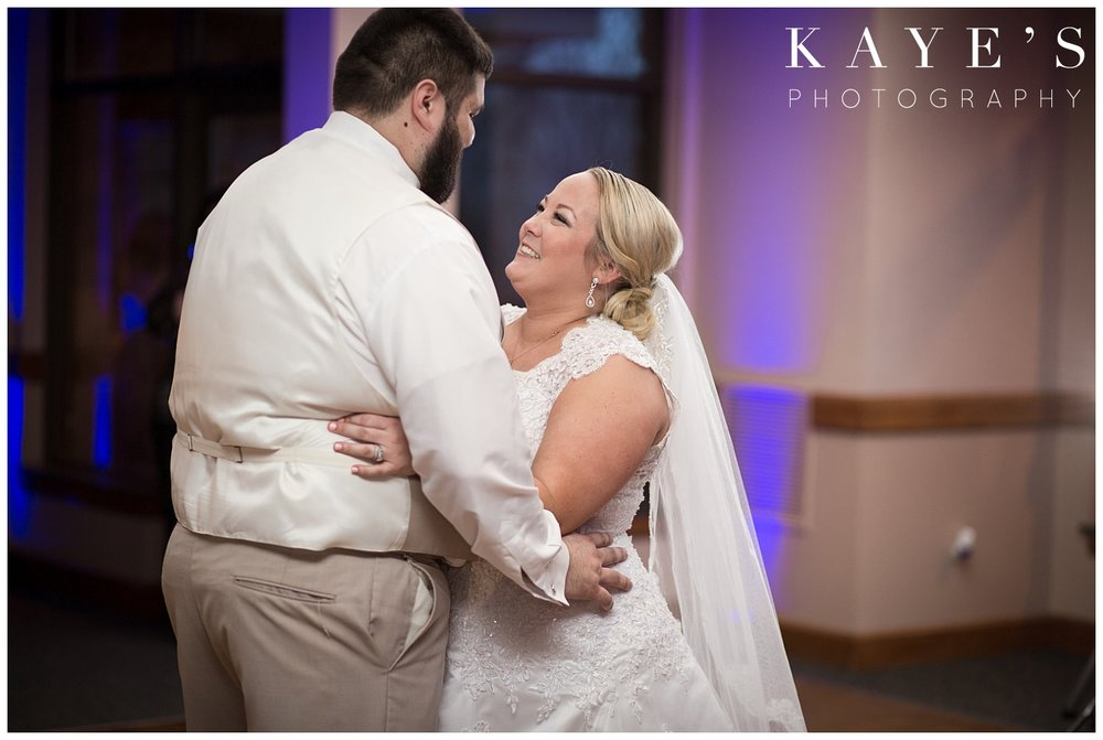 first dance for bride and groom during reception at lapeer country club by kayes photography