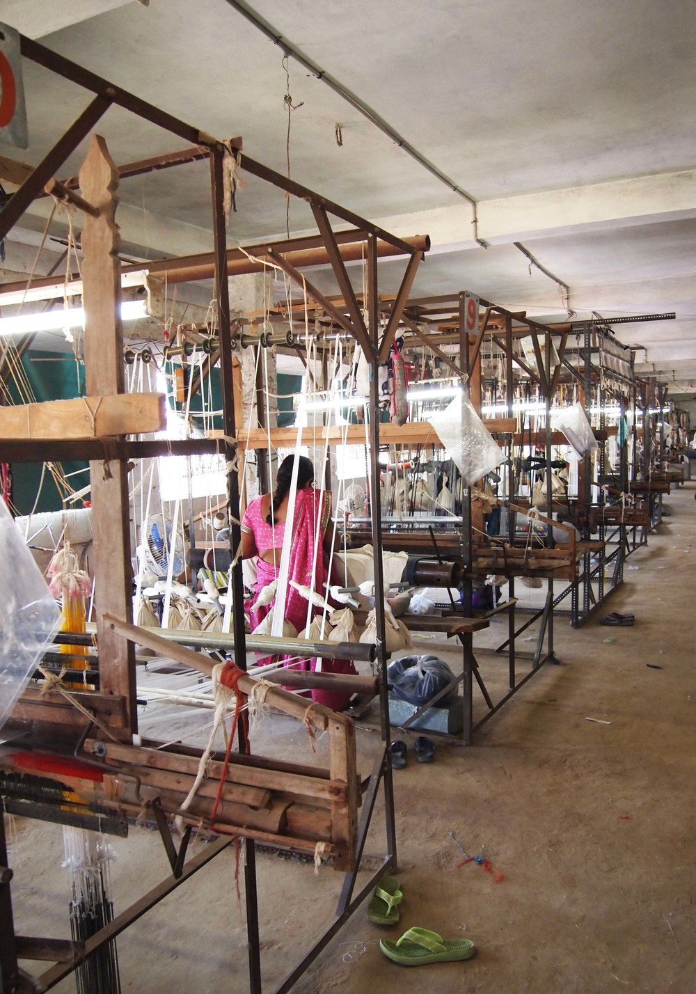 The airy studio space filled with looms in action