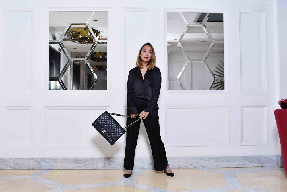 Charmaine wears the EMMA Silk Jacket and MANON Silk Trousers in Black. Shoes and accessories all Charmaine's own