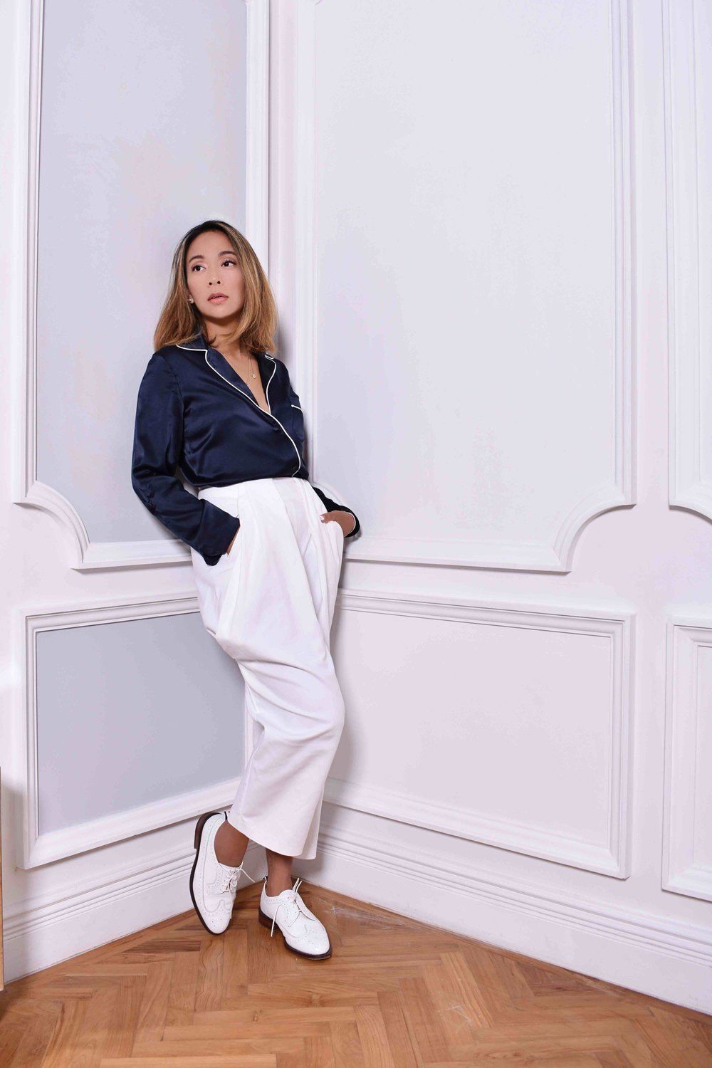 Charmaine wears the EMMA Silk Jacket in Midnight Blue and her own trousers and shoes