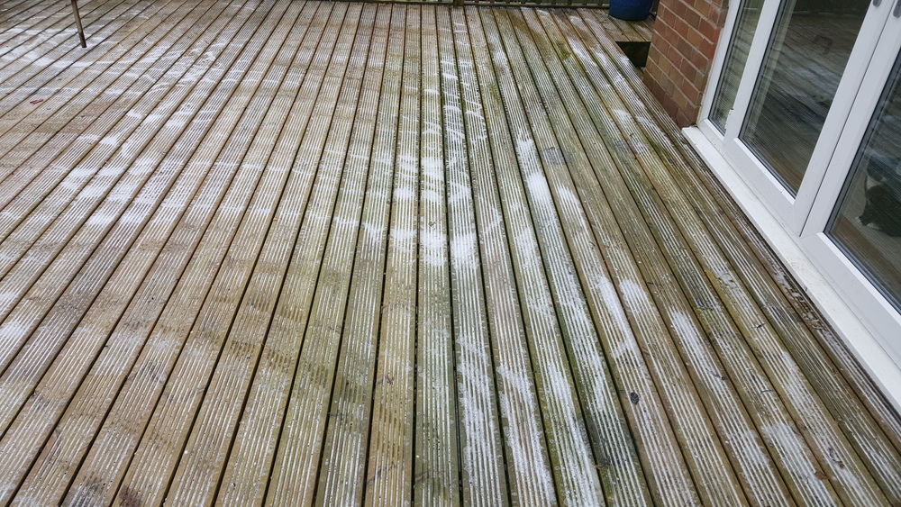 Large wooden decking in Rawtenstall. During Softwash treatment.