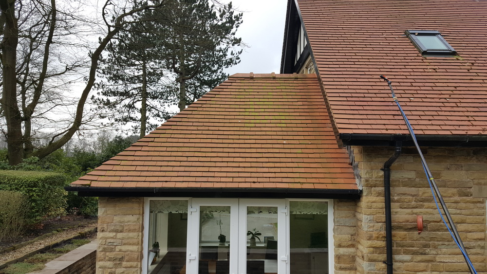 Red clay tile roof on a 4 year old detached property in Withnell near Chorley. Prolific green algae growth all over.