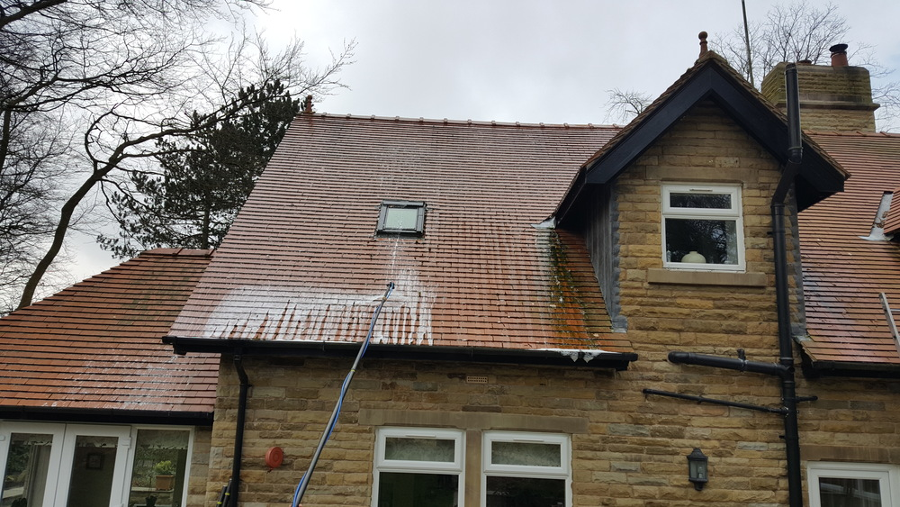 Red clay tile roof on a 4 year old detached property in Withnell near Chorley. Prolific green algae growth all over. During  Softwash treatment.