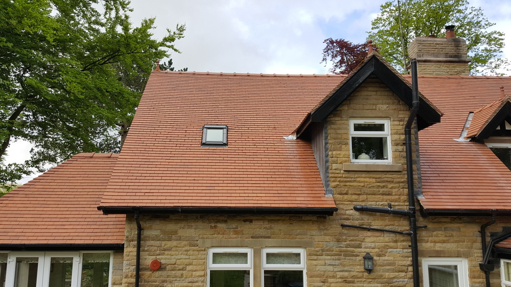 Red clay tile roof on a 4 year old detached property in Withnell near Chorley. After Softwash treatment.