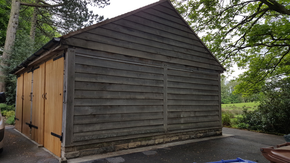 Timber clad garage at the same address after being treated with Softwash solution.