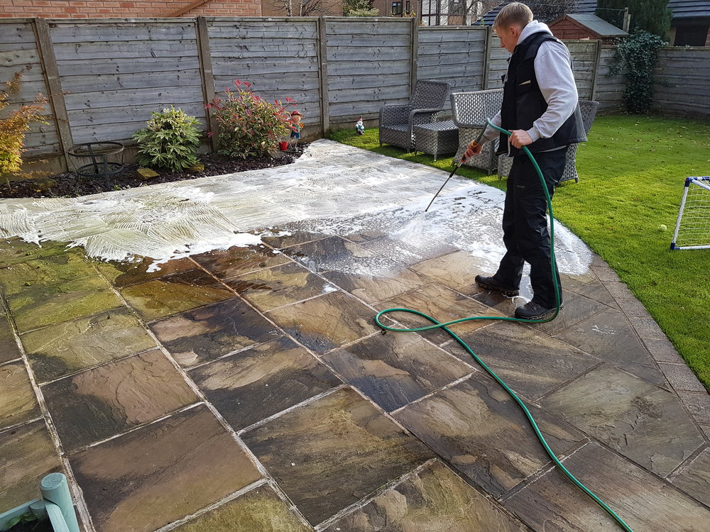 Softwash treatment on Indian stone patio in Rawtenstall.