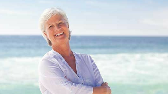 Image. Woman on beach in retirement