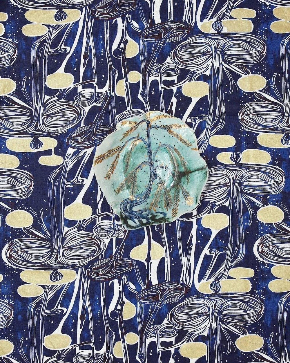 'Untitled' ceramic painting by artist Ruan Hoffmann on his 'Waterlilies' fabric. Photograph Martin Hahn.