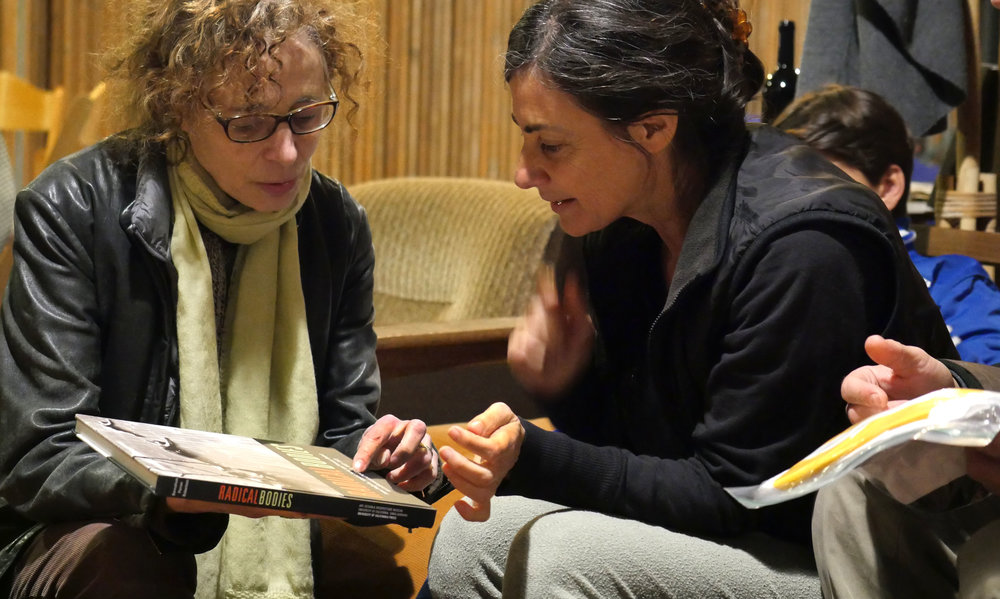 I'm showing Noa Wertheim the book I co-wrote on Anna Halprin, whom she had worked with. Photo by Cari Ann Shim Sham