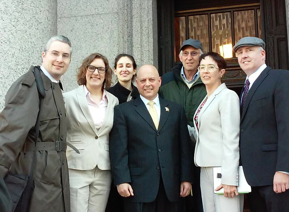 HLAA-NYC Member Jerry Bergman (third from right) with NYPD officers with hearing loss including Dan Carione (center) and Jim Phillips (extreme right) who successfully fought for the right of police officers who wear hearing devices to remain on the job.  Others in the photo are members of Officer Carione's legal team.