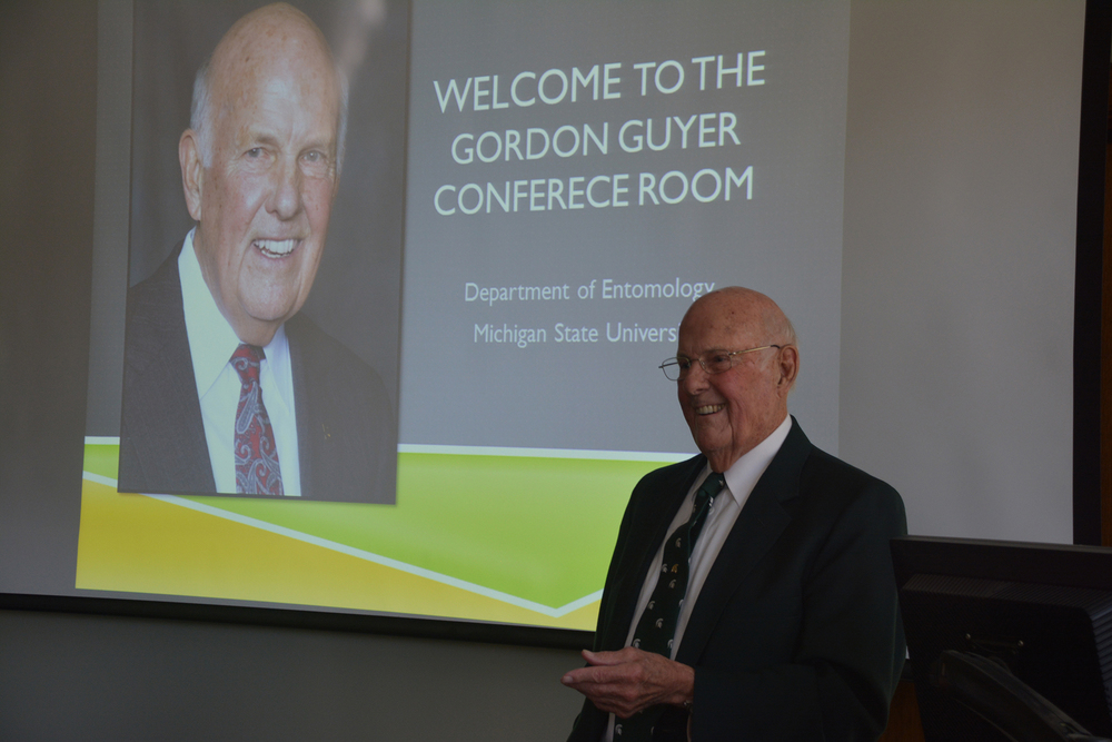 Guyer addresses the audience at the dedication of a conference room named in his honor at the MSU Department of Entomology on Nov. 2, 2014. Photo courtesy of the MSU Department of Entomology.