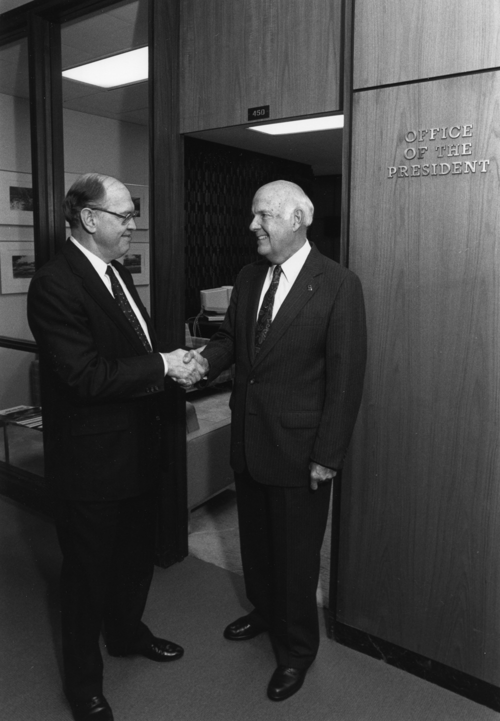 Guyer poses with former MSU President Peter McPherson at the John A. Hannah administration building at MSU. Photo courtesy of MSU Archives.