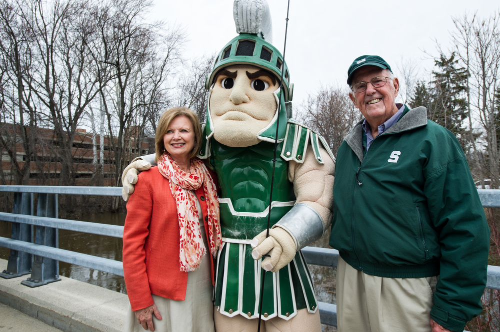 Guyer, along with MSU Provost June Youatt and Sparty, took part in an April 15, 2013, ceremony in which 3,000 steelhead were re-introduced to the Red Cedar River. Photo by Matt Hallowell.