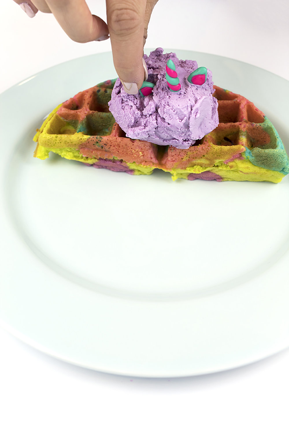 You've got to try this recipe for a Lisa Frank Tie-Dye Waffle Sundae! It's perfect for a 90's theme slumber party or a fun breakfast for the kiddos! #tiedye #lisafrank #icecreamsundae