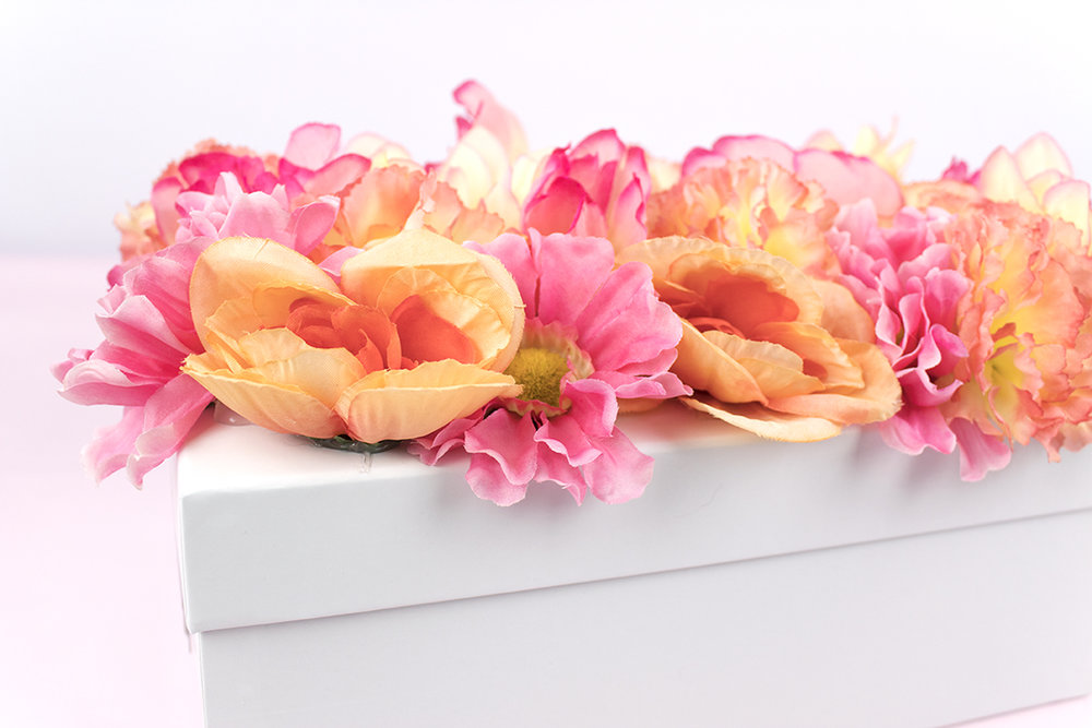 Need a gift box or bridesmaid box that'll put a spring in her step? Look no further! This box is easy and affordable, plus it's a great conversation piece! Click for the full how-to, plus some tips on what to put inside.