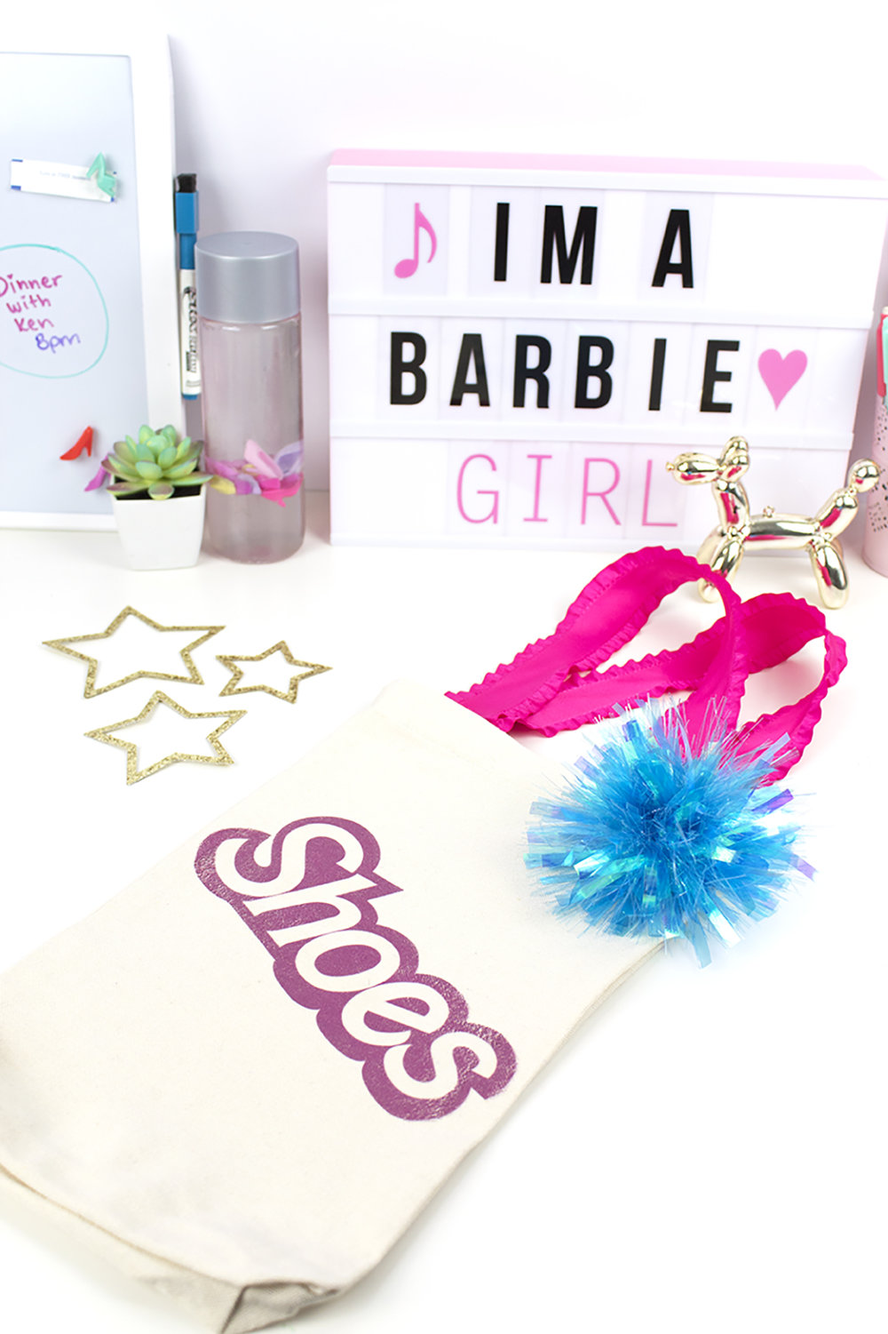 As a Barbie collector, fan, and self-titled Barbie Girl, I could not WAIT to create a Barbie Doll themed DIY. This tote bag features a pink Barbie shoes iron-on. Click for the DIY and free printable! #barbiedoll #totebag #barbieclothes