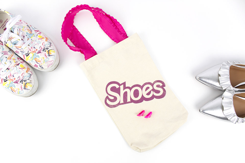 As a Barbie collector, fan, and self-titled Barbie Girl, I could not WAIT to create a Barbie Doll themed DIY. This tote bag features a pink Barbie shoes iron-on. Click for the DIY and free printable!