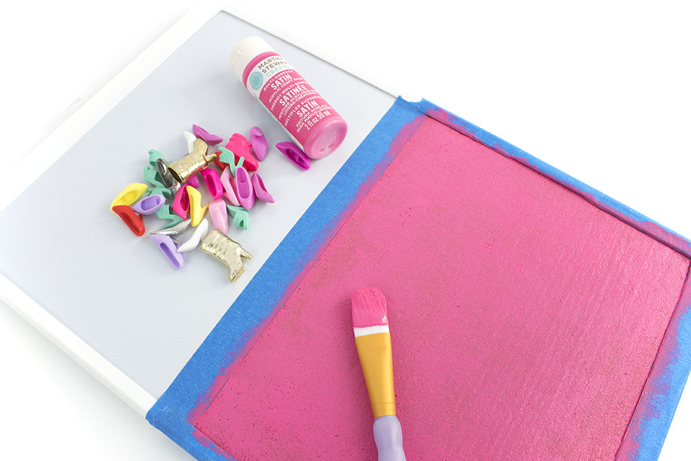 I decided to use my slight obsession with Barbie to create this awesome pink cork board with matching Barbie shoe magnets and thumbtacks. Click for the full tutorial!