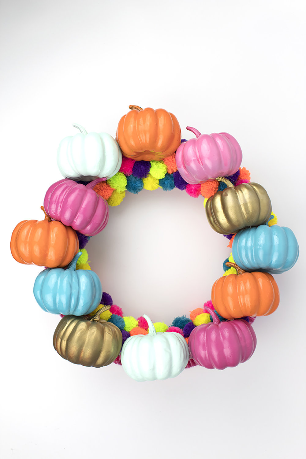 In order to celebrate this weird Summer-Fall hybrid, I crafted a colorful pumpkin wreath to bridge the gap between the seasons. It's got a few of my favorite things- bright colors, pumpkins, and POM POMS!! It's a little kooky, but all the best people are ;) #pompomcrafts #fallcrafts #pumpkins