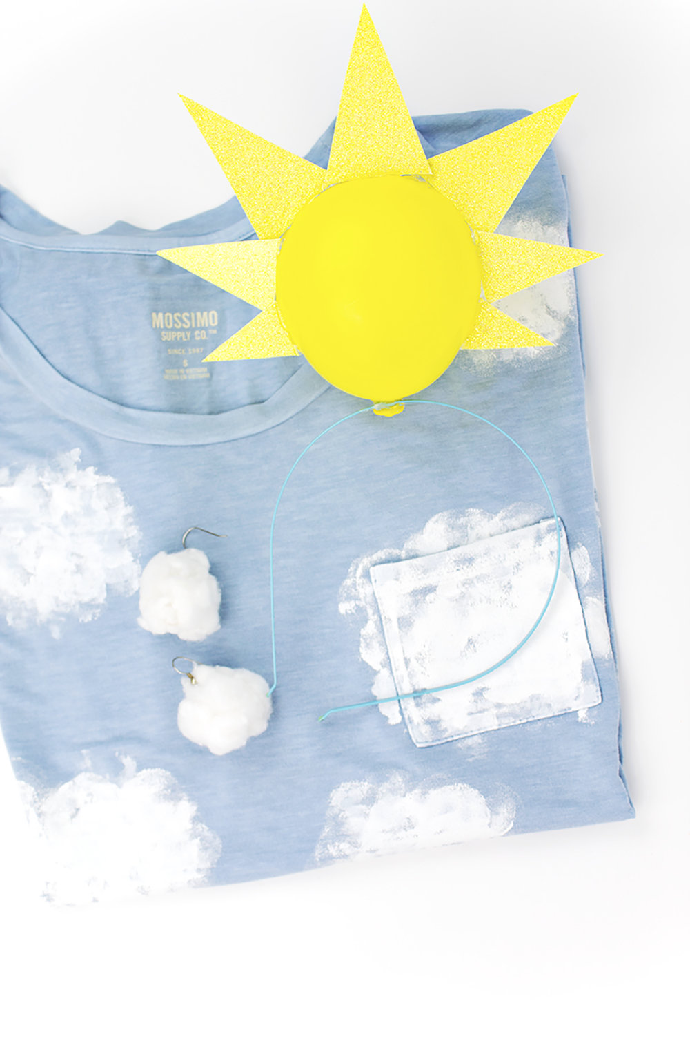 Looking for a quick and easy Halloween costume? Look no further! This last-minute cloud costume is made from a staple everyone has in their closet- a t-shirt! Click for the easy DIY.