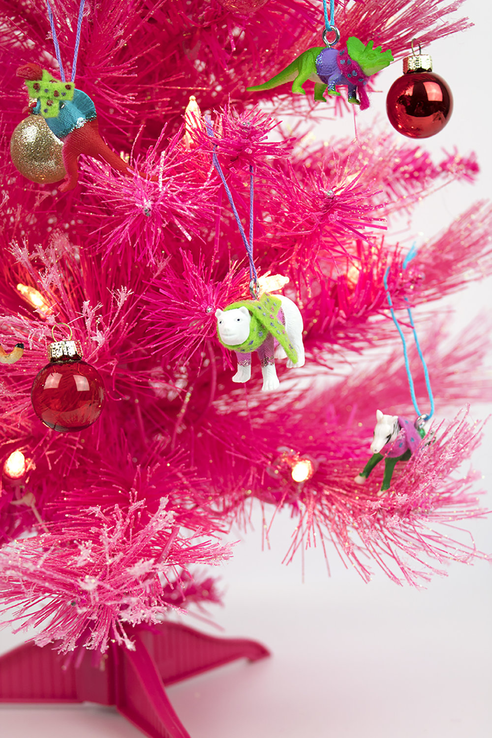 You need these festive friends on your tree! The best part (aside from how adorably colorful they are) is that they're not breakable! Plus, you can make them in any color scheme you'd like. So, pop on a Christmas movie, grab your supplies, and get crafting! #diychristmasornament #diychristmassweater #christmadornamentshomemade