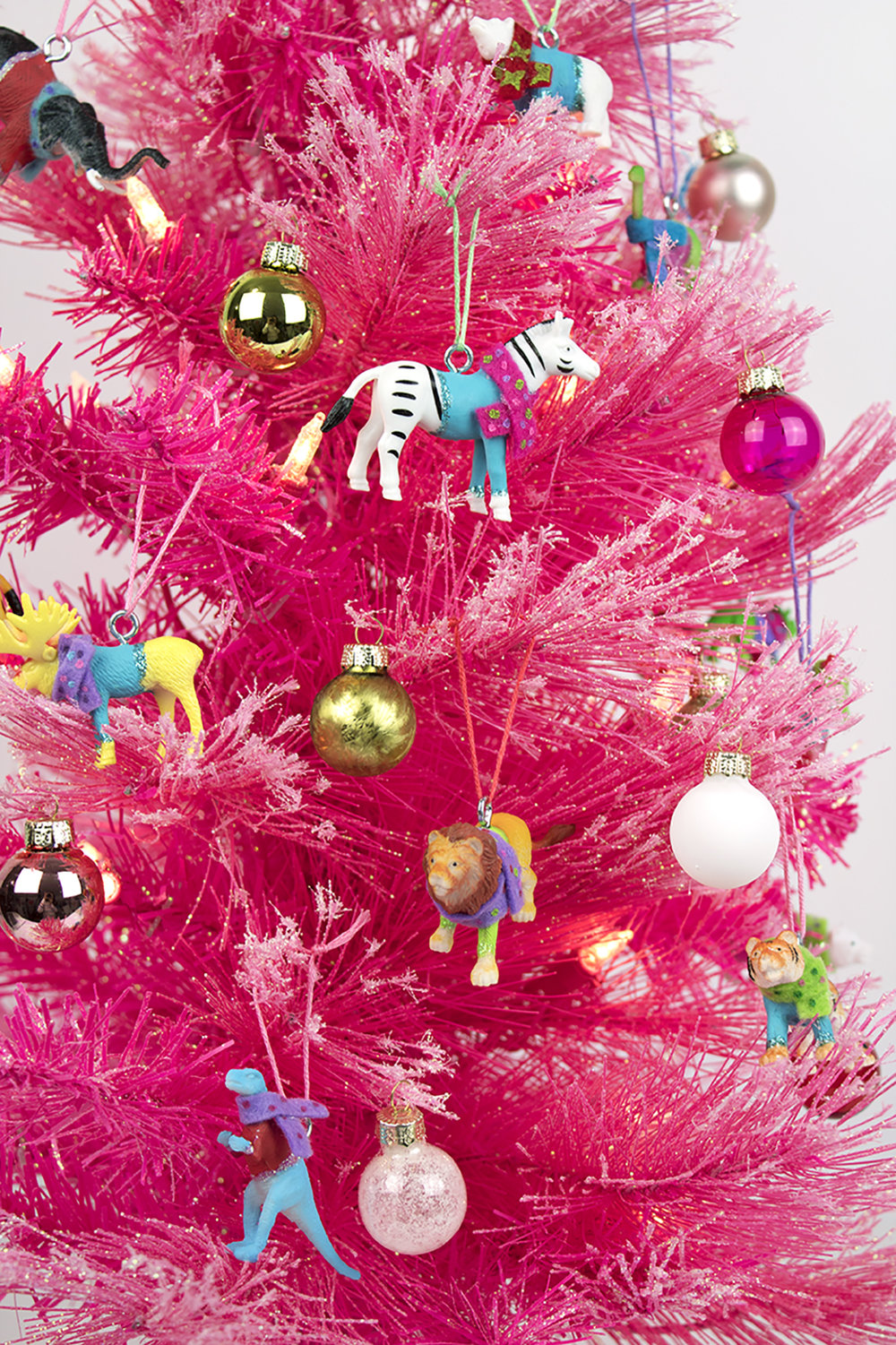 You need these festive friends on your tree! The best part (aside from how adorably colorful they are) is that they're not breakable! Plus, you can make them in any color scheme you'd like. So, pop on a Christmas movie, grab your supplies, and get crafting!