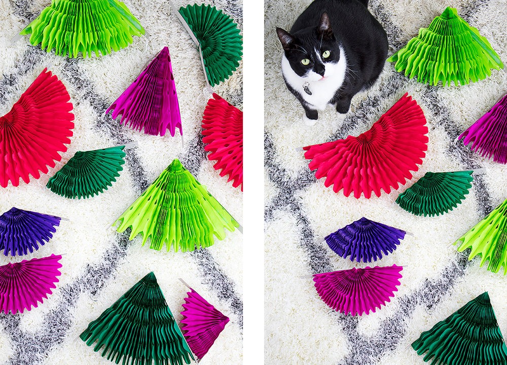 This DIY backdrop only takes a few minutes to put up, and it can be used again and again. It would look really cute starting lower and being a photo prop or even as a Christmas tree alternative for a small space. #paperfans #partybackdrops #christmastreealternative