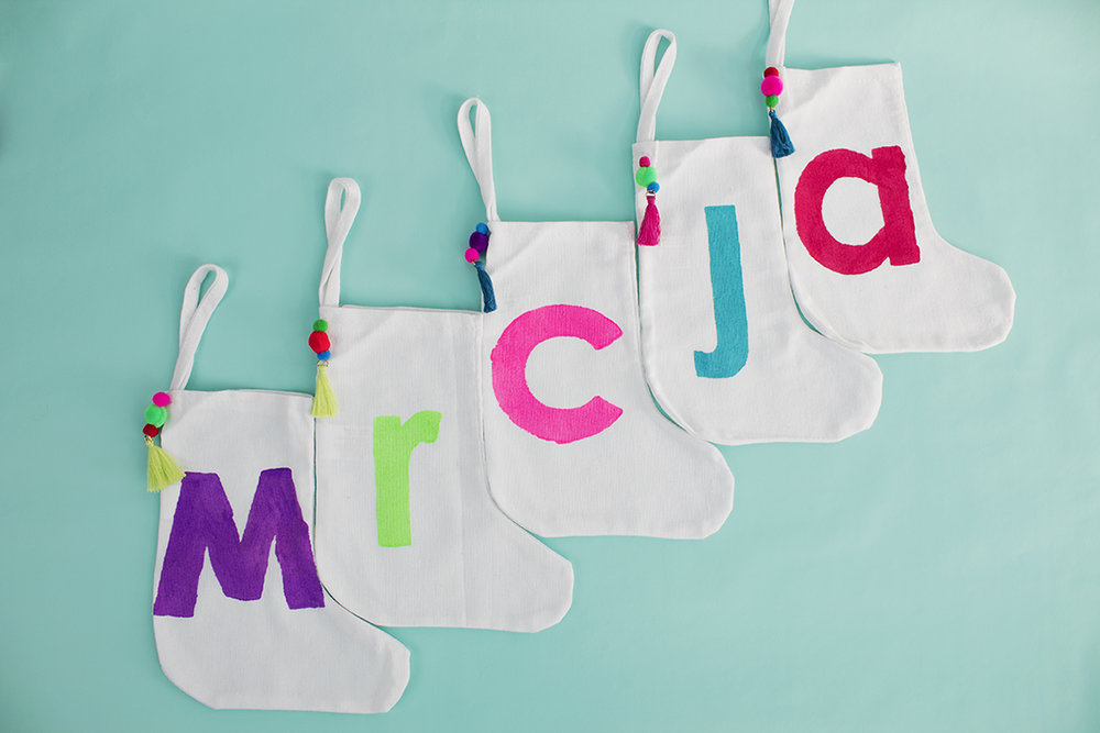 Plain stockings are abundant, but what can you really do with those? Well, how about adding a monogram for every member of your family!? Click for the full tutorial.