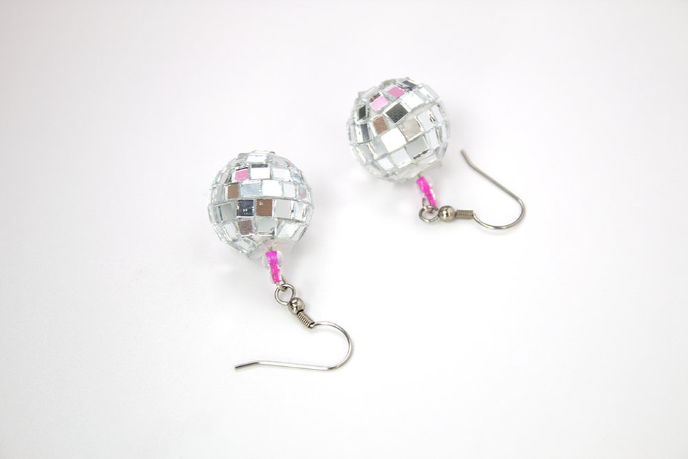 You can wear these earrings anytime there's a party- or anytime you  want  to party. They're super easy to make and lightweight. Check out the DIY now!