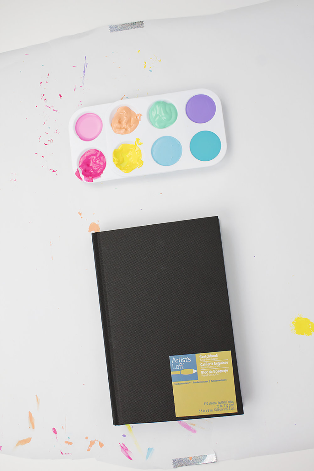 Give your ho-hum notebook a new look with just a coat of paint! Add a metallic accent and you're golden! Click for the DIY.