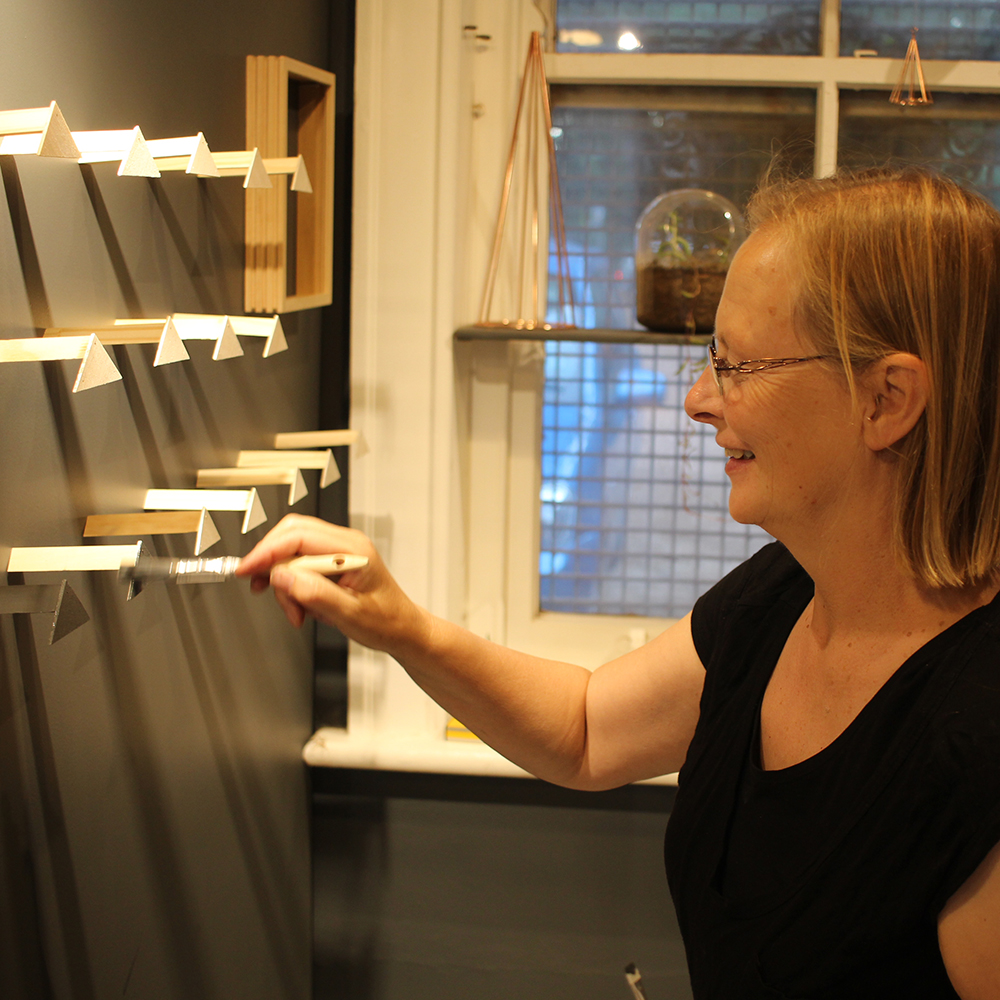 My lovely mum painting our new earring display!