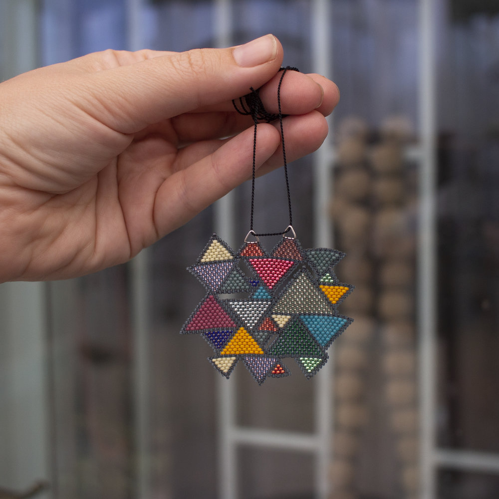 A piece of geometric beadwork titled 'Abramic Faith'.