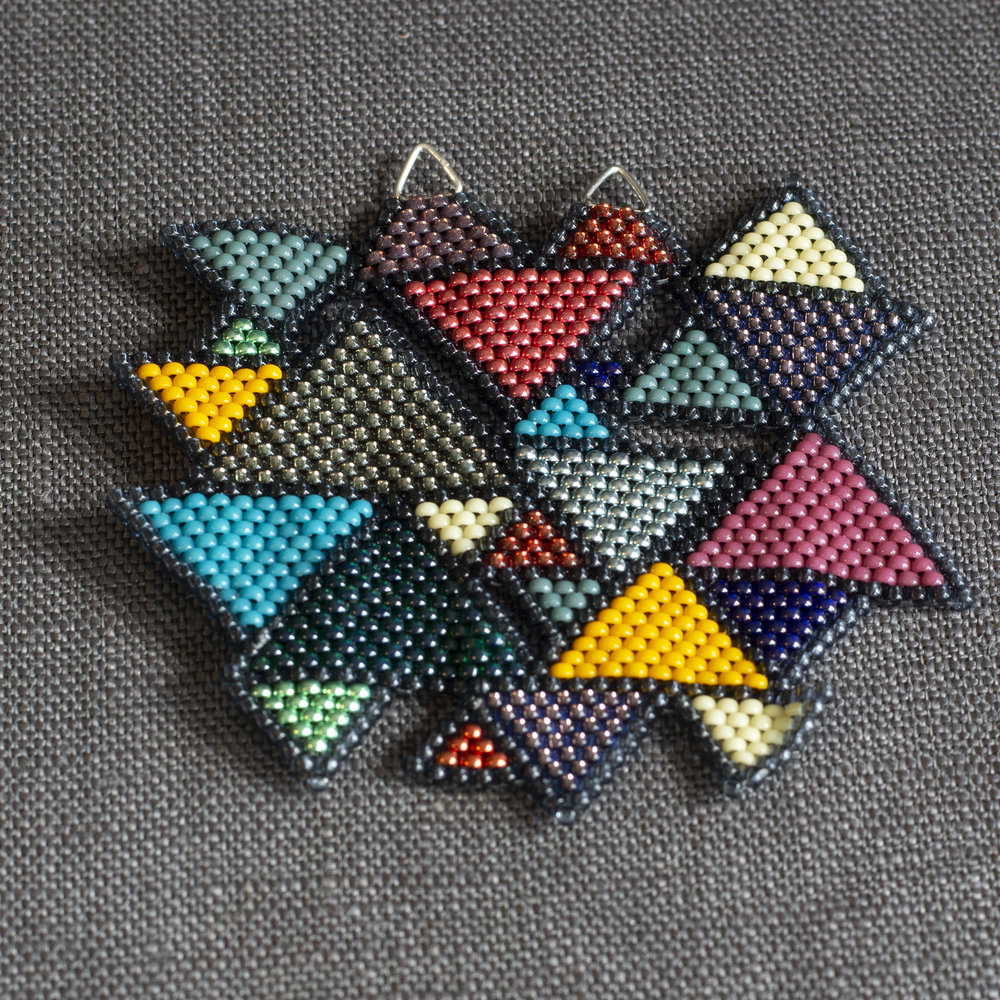 A piece of geometric, colourful beadwork titled 'Abramic Faith'.
