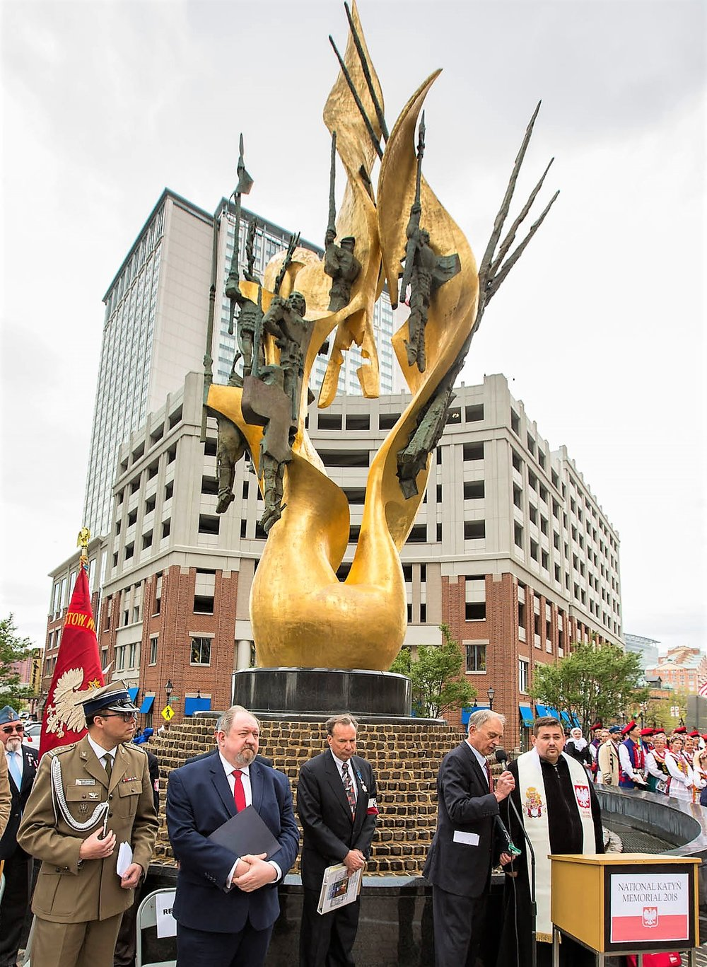 At the National Katyn Memorial.  Shown at the opening ceremonies of the 18th Annual Katyn Remembrance in Baltimore are, from left, Colonel Michal Sprengel and Minister/Counselor Piotr Erenfeicht – both representing the Embassy of the Republic Poland, MC Thomas Rybczynski and Chairman Richard Poremski – both NKMF officers, and Fr. Ryszard Czerniak – Holy Rosary Church, all assembled in front of the National Katyn Memorial.