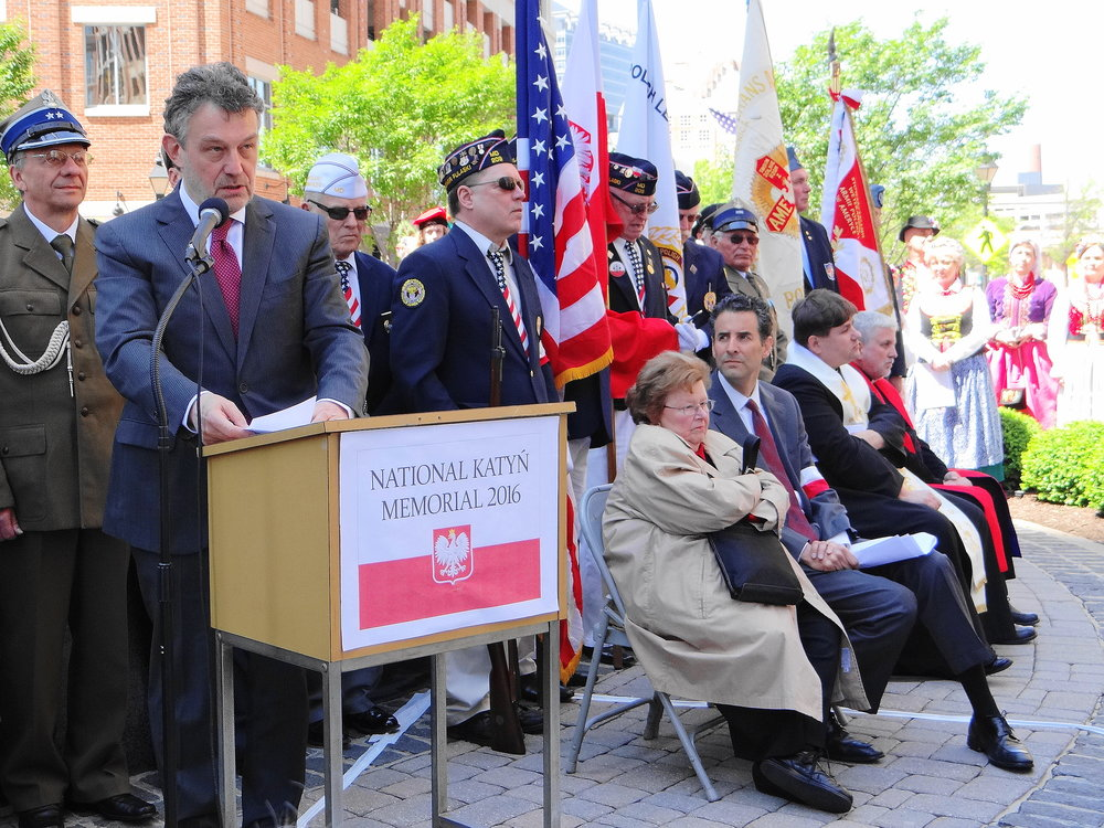 Powerful Words Were Spoken by All.  Pictured is Poland's Ambassador Ryszard Schnepf delivering his pointed remarks at the 16th Annual Katyn Remembrance, at the base of the National Katyn Memorial which was dedicated on November 19, 2000. Speakers seated at right are U.S. Senator Barbara A. Mikulski and U.S. Congressman John Sarbanes.