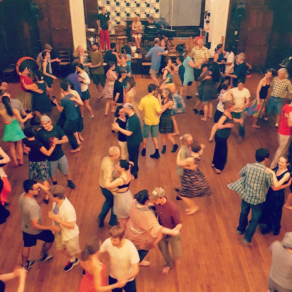 Dancers swinging at the June 16, 2016 PICD dance. Dugan Murphy and Audrey & Clayton performing. Photo by Dela Taylor.