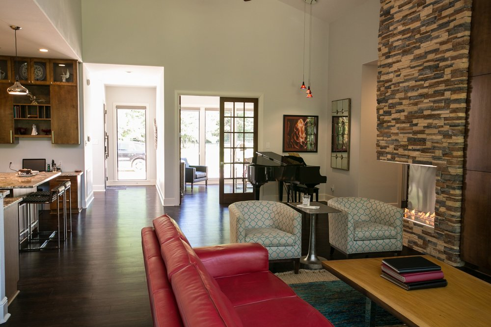 Clean, contemporary living room with rock fireplace