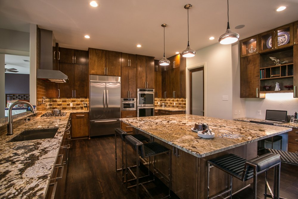 Kitchen with large granite island - nacogdoches, texas designer