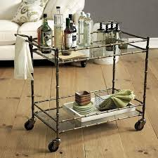 This style is referred to as a Jill Bar Cart with the brass rattan styling and glass shelves.