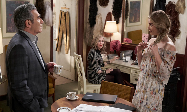 Johnny Rose (Eugene Levy) and Alexis Rose (Annie Murphy) try to have a serious conversation in the midst of Moira Rose's (Catherine O'Hara) wigs.
