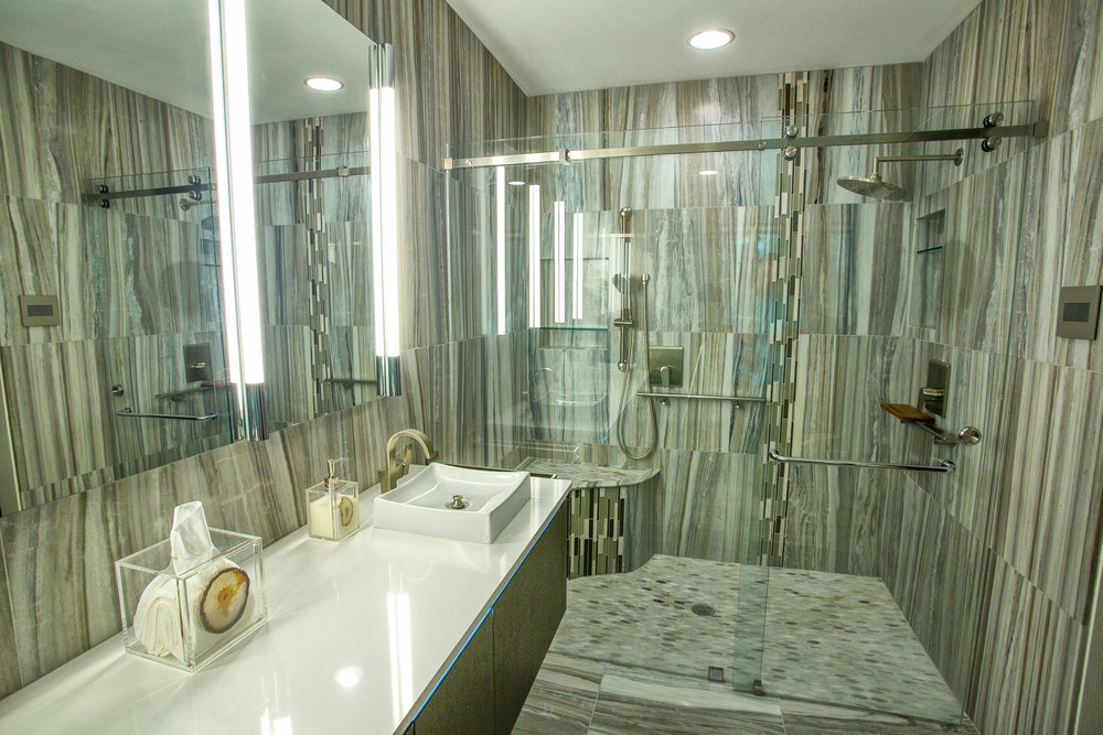 Designer+master+bathroom+with+beautiful+marble+walls.jpeg