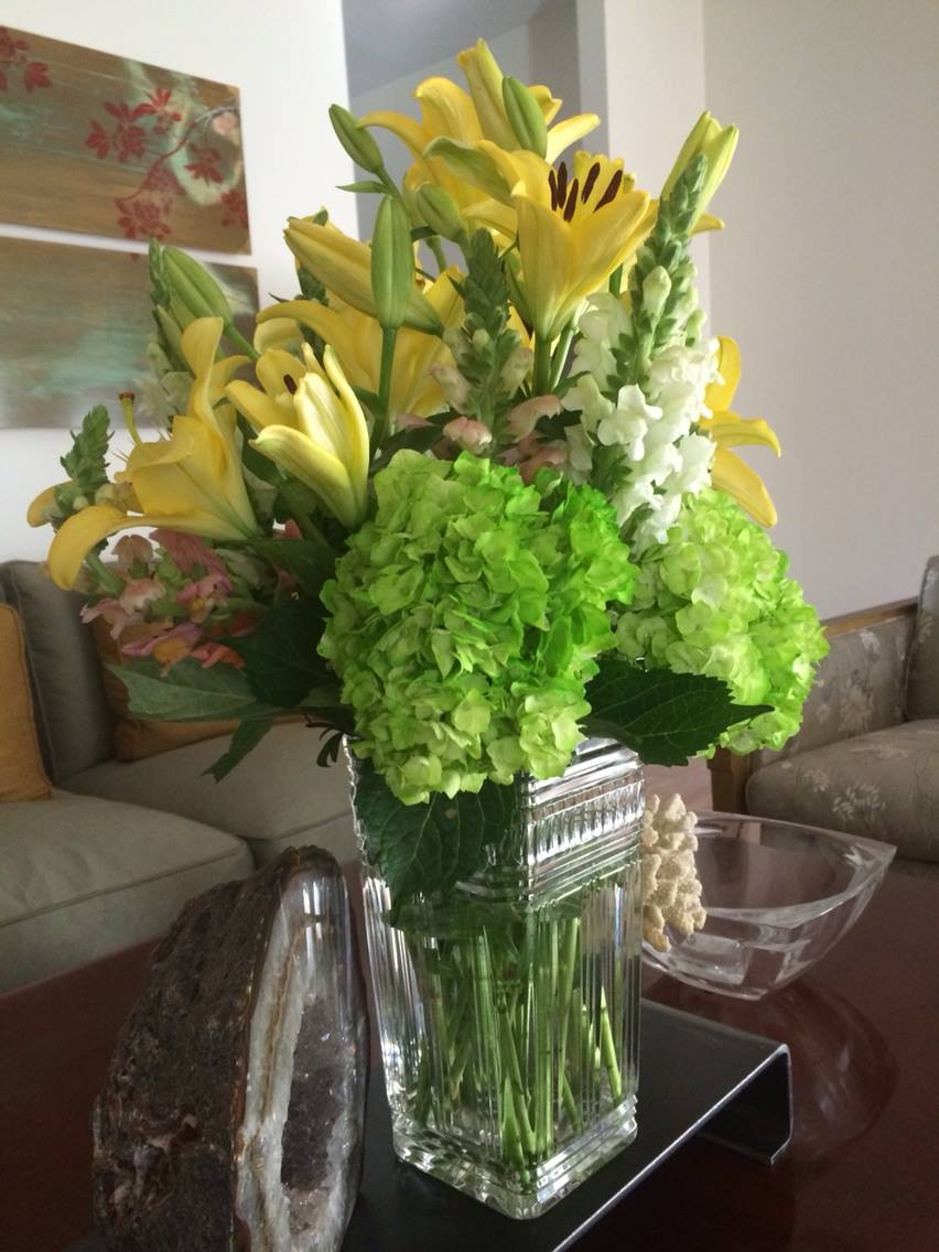 I'm not a florist and these did not come out of our garden - they're from the grocery store. Yet these simple flowers arranged easily in my Mother's favorite vase brightened our living room for a party.