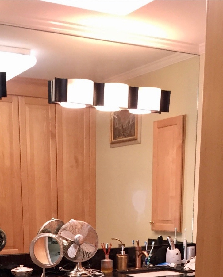 BEFORE - The worst lighting in my bathroom with over the mirror lighting and an awful overhead fluorescent fixture.