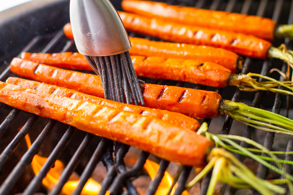 Basting grilled carrots on grill.jpg