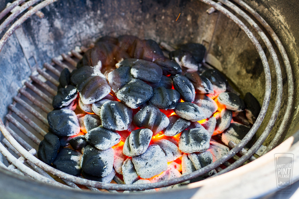 lit coals in weber summit charcoal grill.jpg