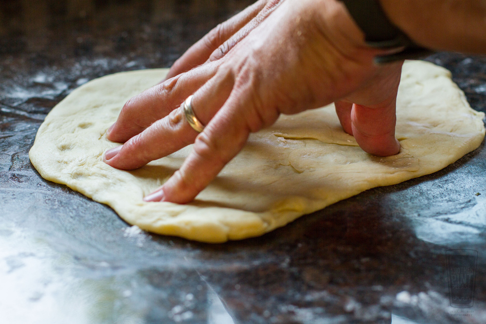 stretching pizza dough.jpg