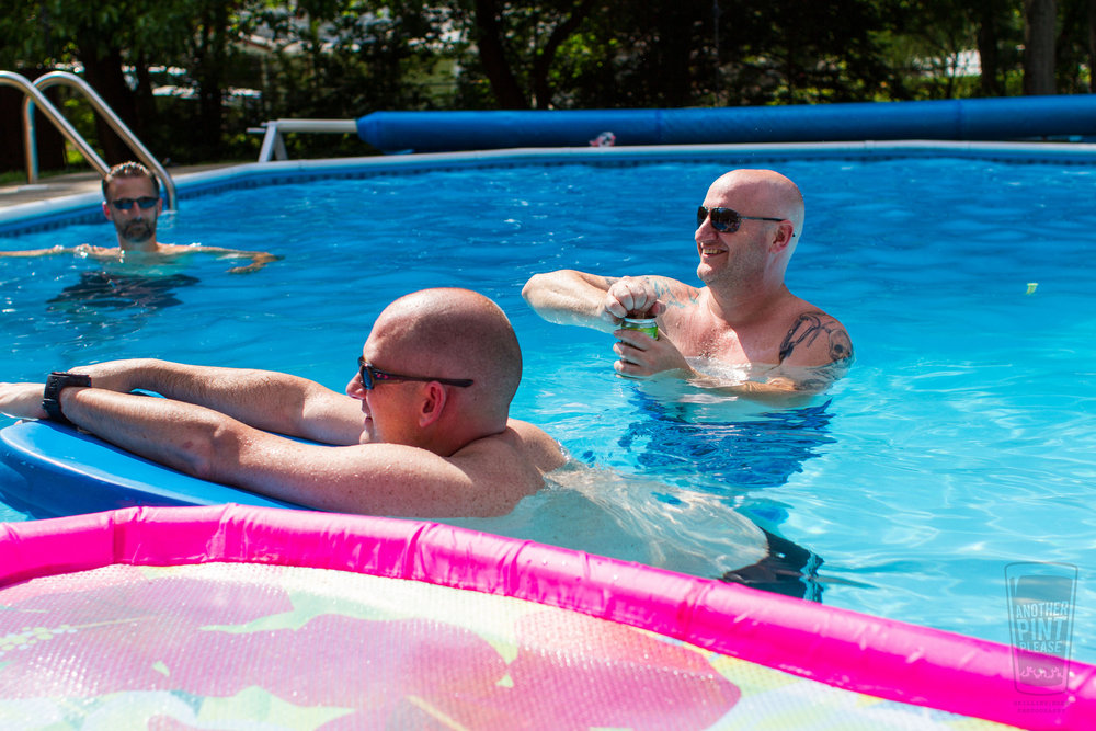 guys drinking beer in pool.jpg